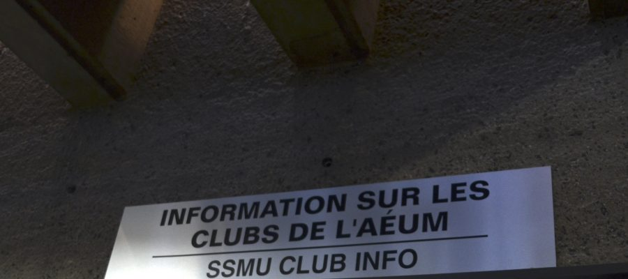 "A photograph of the clubs info sign in the Shatner building that says ""Information Sur Les Clubs de L'AEUM"""
