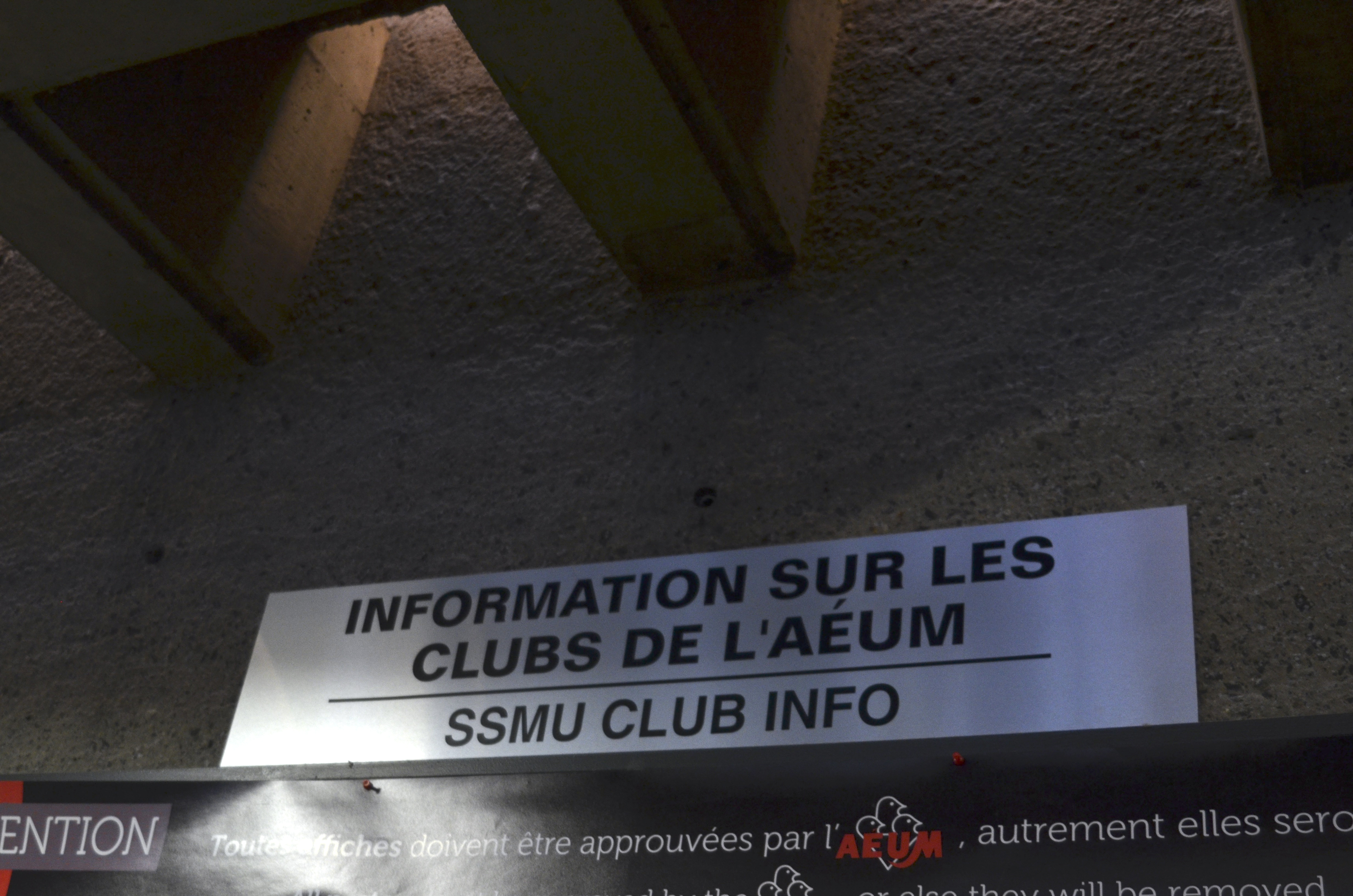 """A photograph of the clubs info sign in the Shatner building that says """"Information Sur Les Clubs de L'AEUM"""""""