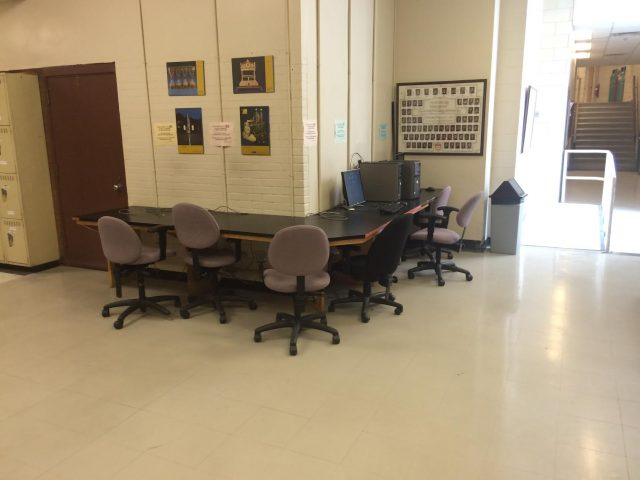 A table with a few chairs and a single computer is the only designated study space in a building that accommodates over 300 students.