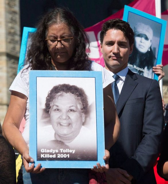Bridget stands beside Justin Trudeau. Photo courtesy of Yahoo News Canada.