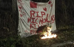 Banner along a fence along the train tracks at Maisonneuve and Montclair, NDG (spot where Gibbs was killed). The banner reads RIP Nicholas. Candles are lit below the banner.