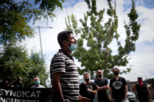 Former warehouse worker Gaurav Sharma performs a short play about his Dollarama experience at a protest in August